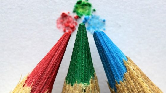 closeup of colored pencil tips touching